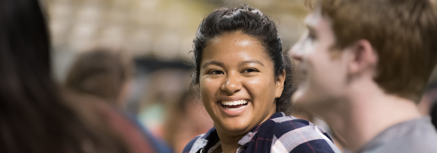Girl smiling in the Kibbie Dome